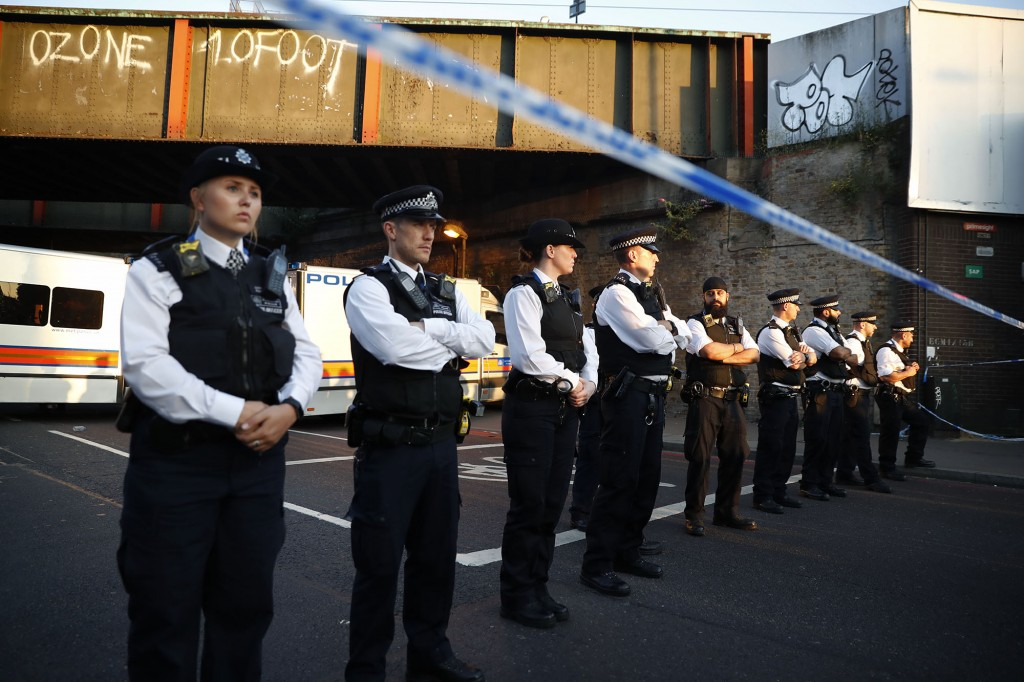 """Police man a cordon at the scene in the Finsbury Park area of north London after a vehichle hit pedestrians, on June 19, 2017. One man was killed and eight people hospitalised when a van ran into pedestrians near a mosque in north London in an incident that is being investigated by counter-terrorism officers, police said on Monday. The 48-year-old male driver of the van """"was found detained by members of the public at the scene and then arrested by police,"""" a police statement said. / AFP PHOTO / Tolga AKMEN (Photo credit should read TOLGA AKMEN/AFP/Getty Images)"""