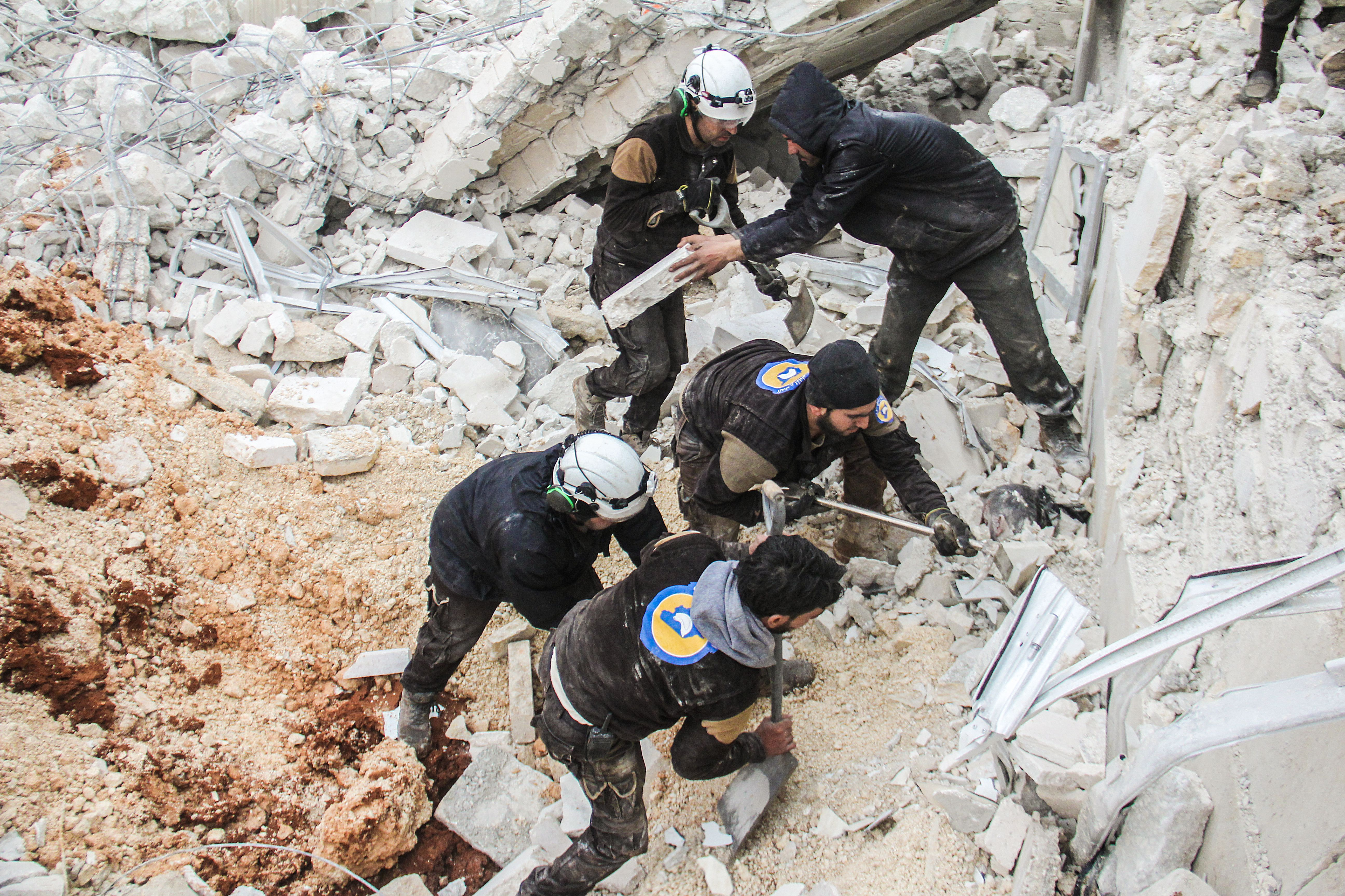 Syrian civil defence volunteers, known as the White Helmets, dig through the rubble of a mosque following a reported airstrike on a mosque in the village of Al-Jineh in Aleppo province on March 17, 2017. The US military says it carried out an air strike in northern Syria against an Al-Qaeda target, but denies deliberately targeting a mosque where dozens were killed according to the Syrian Observatory for Human Rights. / AFP PHOTO / Omar haj kadour        (Photo credit should read OMAR HAJ KADOUR/AFP/Getty Images)