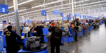 Clarkston. Washington state. USA_Americans shopping on christmas eve at Walmar store and cashier wearing santa claus hat in christmas celebration mode 24 December 2014. ( Photo by Francis Joseph Dean/Deanpictures) (Photo by Francis Dean/Corbis via Getty Images)