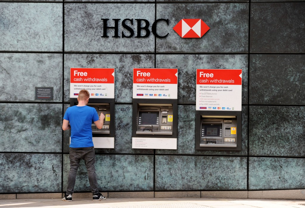 HSBC profits. File photo dated 15/09/14 of HSBC cash machines, as the bank reported a 29% slump in pre-tax profits for the first half of 2016 amid concerns over the EU referendum and the economic outlook in China. Issue date: Wednesday August 3, 2016. Britain's biggest bank saw annual pre-tax profits tumble to 9.7 billion dollars (£7.2 billion), compared with 13.6 billion dollars (£10.2 billion) in the same period in 2015. Pre-tax profit in the second quarter plummeted 45% to 3.61 billion US dollars. See PA story CITY HSBC. Photo credit should read: Andrew Matthews/PA Wire URN:28225666