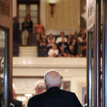 WASHINGTON, DC - JULY 25:  Sen. John McCain (R-AZ) walks into the U.S. Senate chamber on July 25, 2017 in Washington, DC. McCain was recently diagnosed with brain cancer but returned on the day the Senate is holding a key procedural vote on U.S. President Donald TrumpÍs effort to repeal and replace the Affordable Care Act.  (Photo by Mark Wilson/Getty Images)