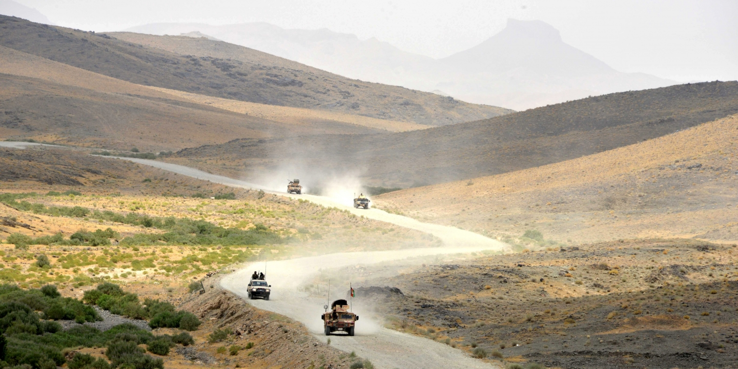Afghan National Army (ANA) soldiers patrol the Shah Wali Kot district of Kandahar province on May 23, 2017.At least 10 Afghan soldiers were killed when militants attacked their army base in the southern province of Kandahar, the defence ministry said May 23, in the latest attack on Western-backed forces. / AFP PHOTO / JAVED TANVEER (Photo credit should read JAVED TANVEER/AFP/Getty Images)