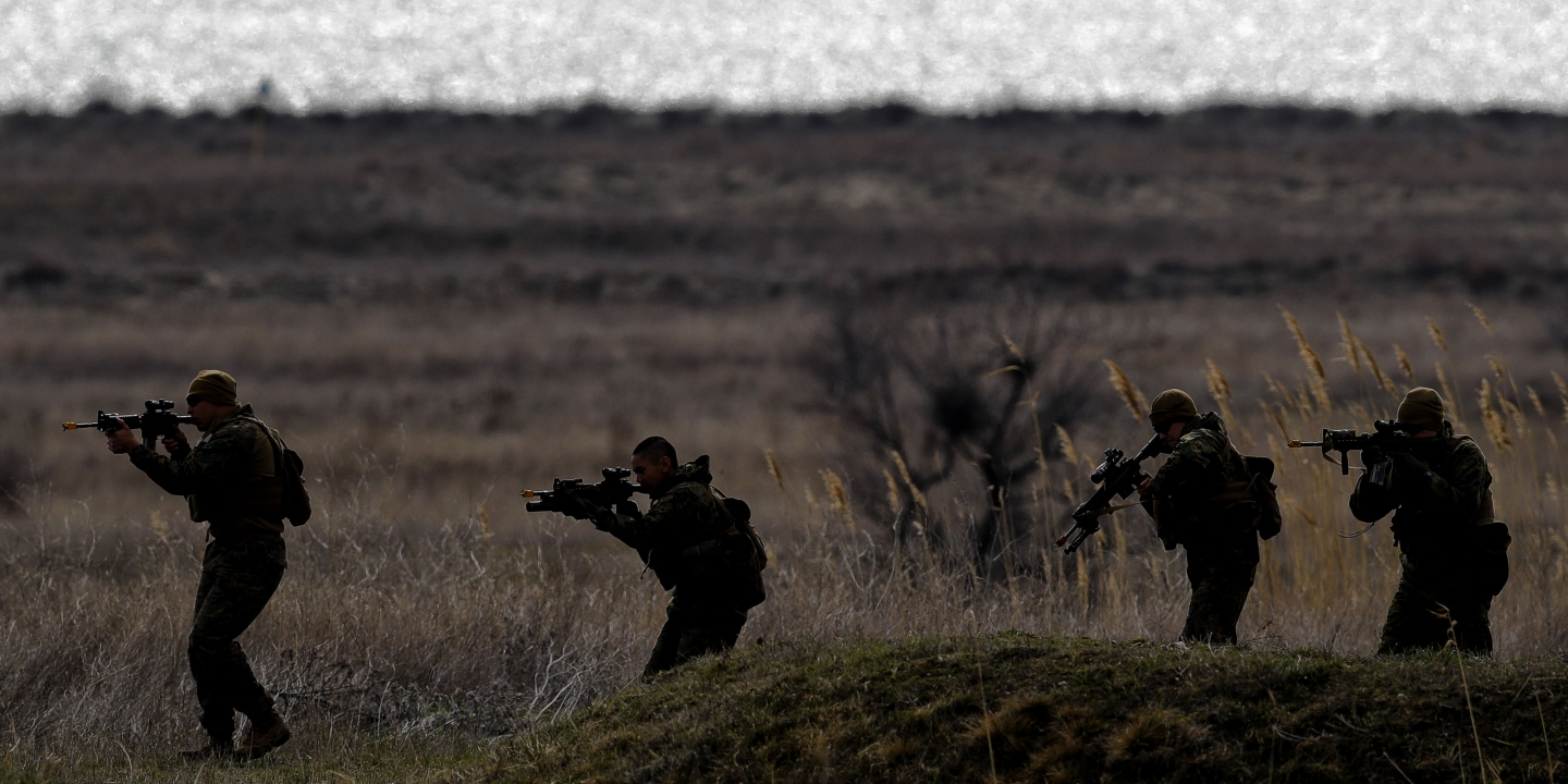 US Marines advance on the Black Sea shore during training at the Capu Midia Surface to Air Firing Range, on the Black Sea coast in Romania, Monday, March 20, 2017. About 1,200 US and Romanian troops take part in the Spring Storm 17 exercise, meant to simulate defense of the Romanian Black Sea coastline and urban areas. (AP Photo/Vadim Ghirda)