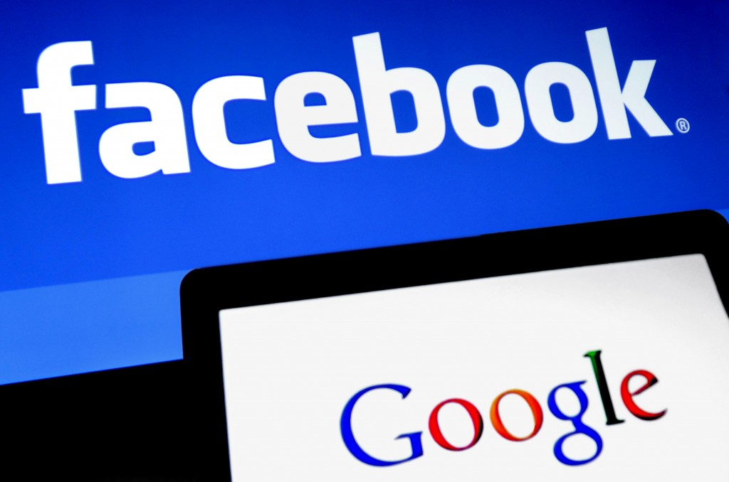 Facebook Inc. and Google Inc. logos are displayed on computer screens in this arranged photo in New York, U.S., on Monday Jan. 30, 2012. A Facebook IPO would provide funds to help the social-networking service maintain its expansion and fend off competition from Internet rivals such as Google Inc. and Twitter Inc. Photographer: Peter Foley/Bloomberg via Getty Images