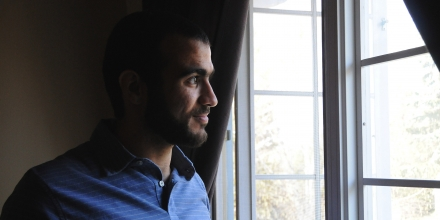 EDMONTON, AB - MAY 9:  Omar Khadr looks out the window of his home on May 9, 2015, two days after being freed after having spent nearly half of his life in custody.        (Michelle Shephard/Toronto Star via Getty Images)