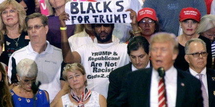 PHOENIX AZ- AUGUST 22 A supporter of U.S. President Donald Trump holds up a sign as the president speaks to a crowd at the Phoenix Convention Center during a rally