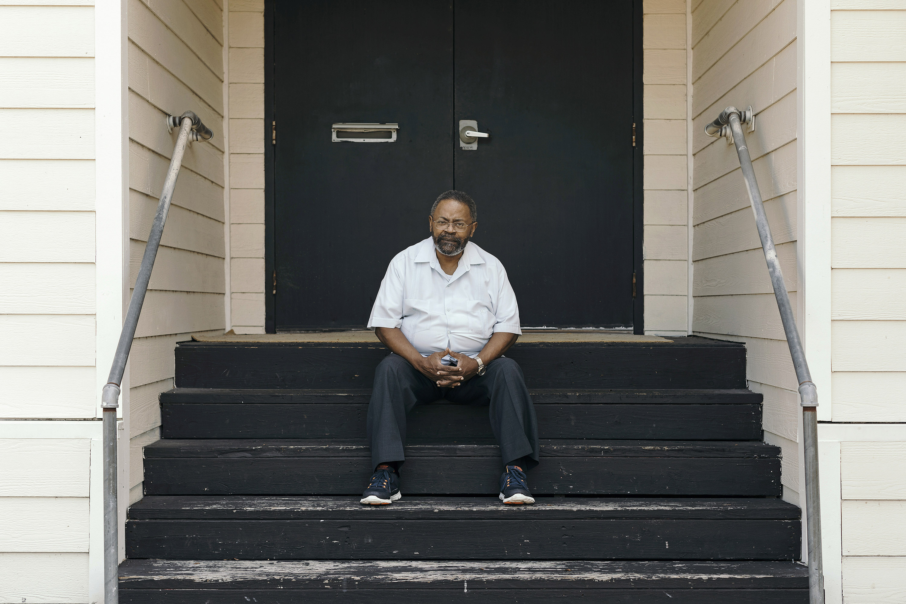 Reverend Roy L. Malveaux of Shining Star Baptist Church sits on the steps of his church, Tuesday, June 6th, 2017 in Beaumont, Texas.Todd Spoth for The Intercept