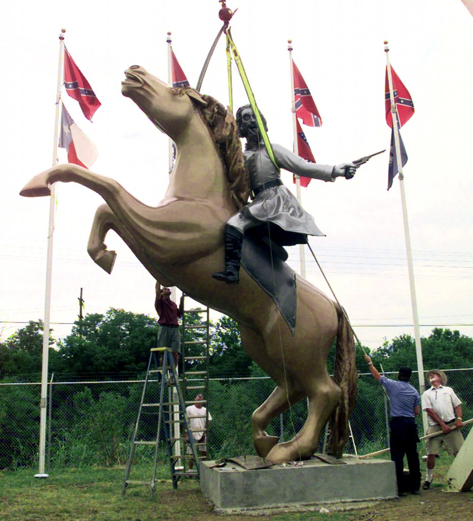FILE -- In this 1998 file photo, a statue of Confederate Gen. Nathan Bedford Forrest is put up on private property along Interstate 65 in Nashville, Tenn. The statue is one of several of Forrest, an early leader of the Ku Klux Klan, that have come under question after a massacre at a black church in Charleston, S.C. Following the massacre, a bipartisan mix of officials across the country is calling for the removal of Confederate flags and other symbols of the Confederacy from public places. (AP Photo/Mark Humphrey, File)