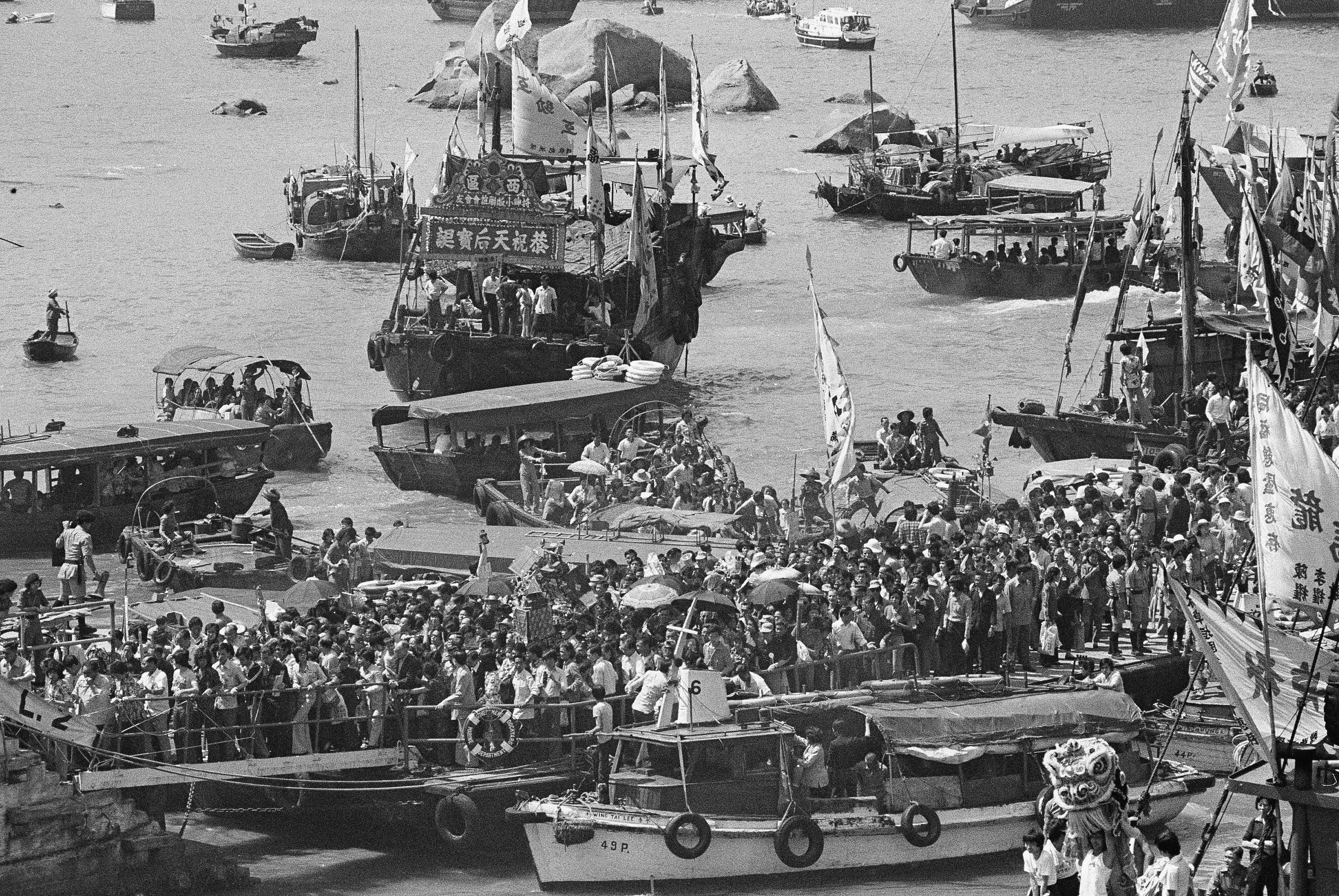 "Fishing boats stopped fishing on April 22, 1976 to pay their annual homage to their patron saint,  the goddess of the sea Tin Hua, on ""Heavenly Peace."" The colorful ceremony is held annually on the 23rd day of the third moon of the Lunar calendar.  (AP Photo)"