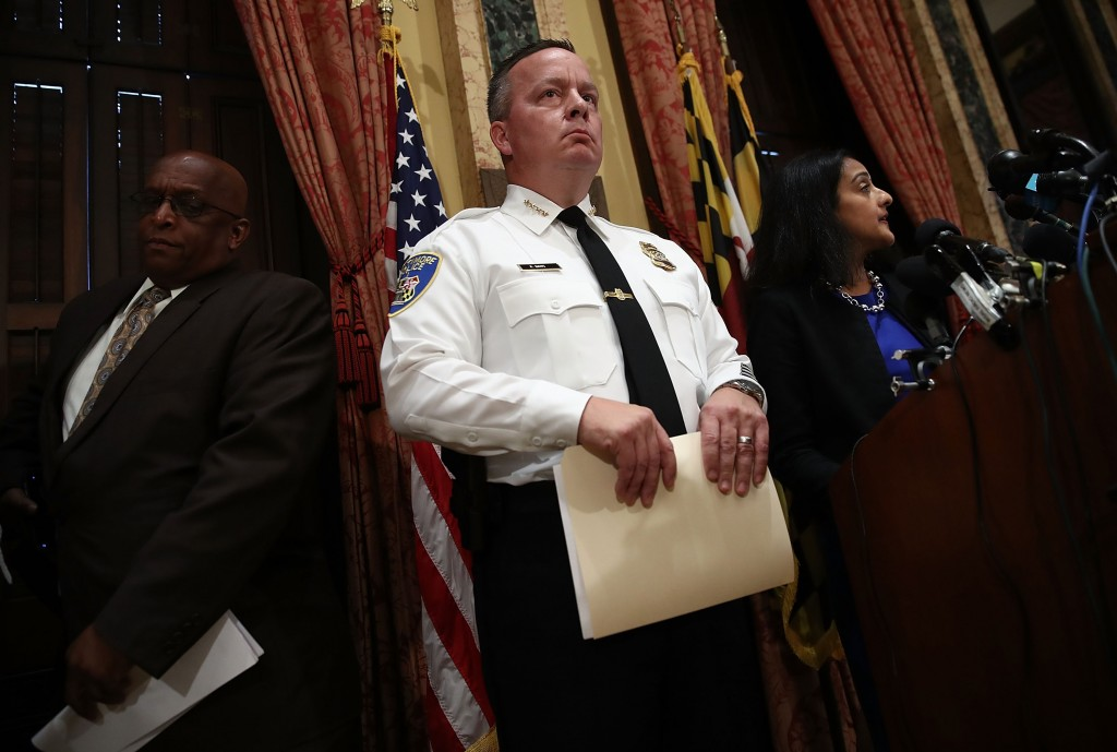 BALTIMORE, MD - AUGUST 10:  Baltimore Police Department Commissioner Kevin Davis (C) listens as  Deputy Assistant Attorney General Vanita Gupta (R), head of the Justice DepartmentÕs Civil Rights Division, speaks during a press conference at City Hall highlighting a Justice Department investigation into the Baltimore City Police Department August 10, 2016 in Baltimore, Maryland. The investigationÕs report is highly critical of the Baltimore Police Department for systematically stopping, searching and arresting the cityÕs black residents, frequently without cause. Also pictured is Baltimore Mayor Stephanie Rawlings-Blake (R).  (Photo by Win McNamee/Getty Images)
