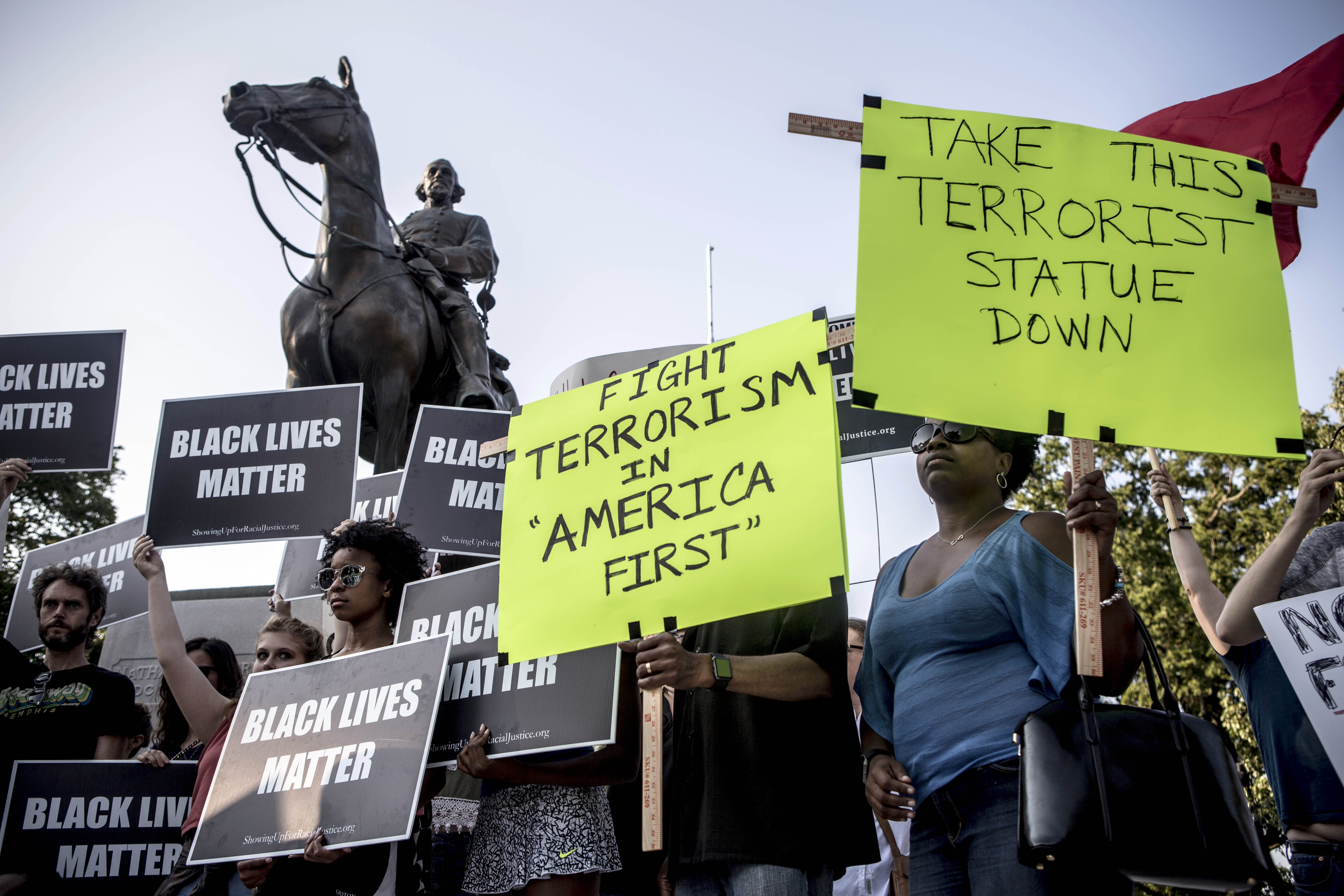 August 12, 2017 - Memphis, TN:  Community members join the #takeemdown901 movement in Memphis and protest at Health Sciences Park. The park was formerly named Forrest Park, after Nathan Bedford Forrest, the Confederate general and grand wizard of the Ku Klux Klan, who has a monument in his honor there. The statue also sits on top of Forrest and his wife's bodies, which were exhumed from their original resting places at the Elmwood Cemetery, when the statue went up in 1905.