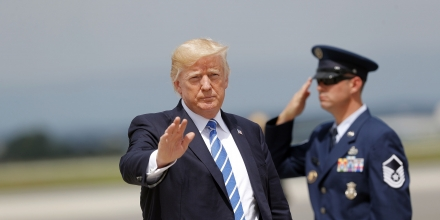 President Donald Trump waves after getting off Air Force One at Hagerstown Regional Airport in Hagerstown, Md., Aug. 18, 2017, en route to nearby Camp David, for a meeting with his national security team to discuss strategy for South Asia, including India, Pakistan and the way forward in Afghanistan.  (AP Photo/Pablo Martinez Monsivais)