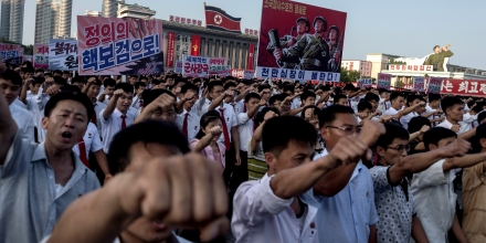 People wave banners and shout slogans as they attend a rally in support of North Korea's stance against the US, on Kim Il-Sung square in Pyongyang on August 9, 2017. US President Donald Trump said the United States' nuclear arsenal was