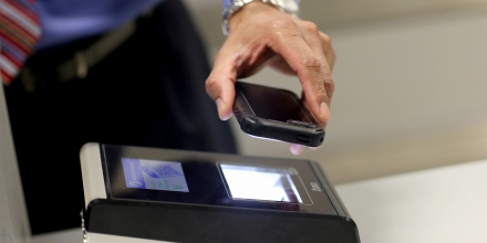 MIAMI, FL - MARCH 04: A phone is passed over a scanner during a demonstration in the use of the new mobile app for expedited passport and customer screening being unveiled for international travelers arriving at Miami International Airport on March 4, 2015 in Miami, Florida. Miami-Dade Aviation Department and U.S. Customs and Border Protection (CBP) unveiled a new mobile app for expedited passport and customs screening. The app for iOS and Android devices allows U.S. citizens and some Canadian citizens to enter and submit their passport and customs declaration information using their smartphone or tablet and to help avoid the long waits in the exit lanes.  (Photo by Joe Raedle/Getty Images)
