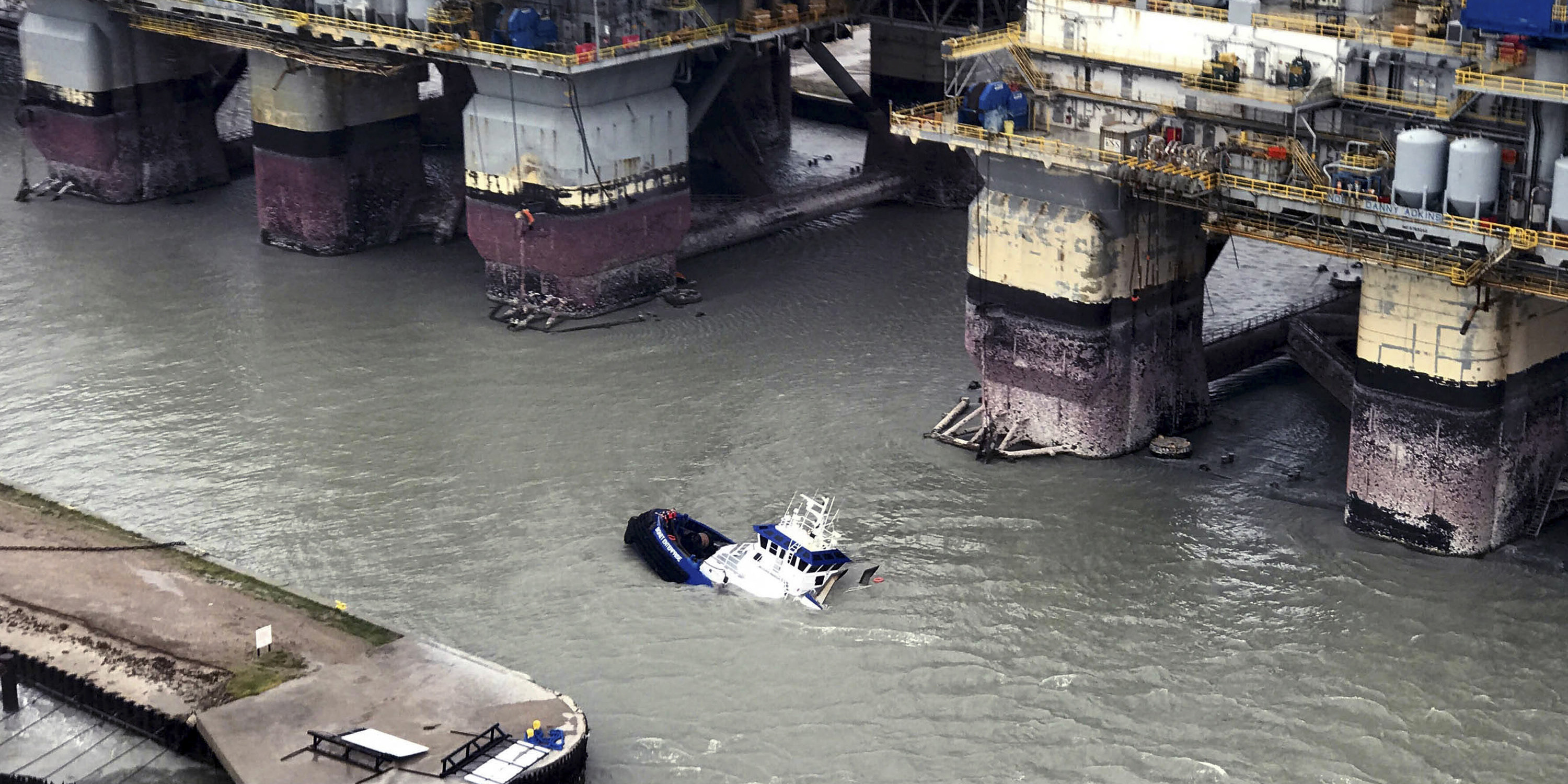 A U.S. Coast Guard handout aerial view of the tugboat Signet Enterprise with it's crew -- later rescued -- standing in the bow of the partially submerged vessel, near Port Aransas, Texas, Aug. 26, 2017. Hurricane Harvey's devastation points out a vulnerability of American oil energy: the concentration of refineries and chemical plants along a Gulf Coast that is vulnerable to bad weather. (U.S. Coast Guard via The New York Times) EDITORIAL USE ONLY