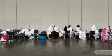 Flood victims are seen at a shelter in the George R. Brown Convention Center during the aftermath of Hurricane Harvey on August 28, 2017 in Houston, Texas. / AFP PHOTO / Brendan Smialowski        (Photo credit should read BRENDAN SMIALOWSKI/AFP/Getty Images)