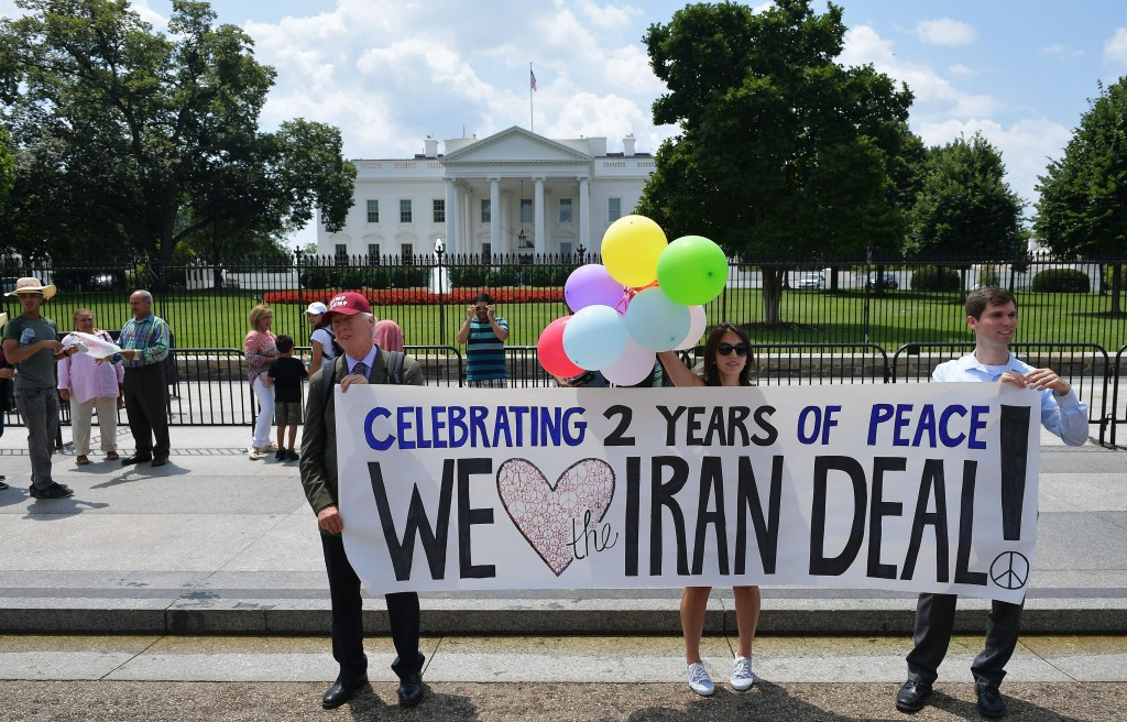 Activist take part in a rally to commemorate the nuclear deal with Iran in front of the White House, on July 14, 2017 in Washington, DC. / AFP PHOTO / Mandel NGAN        (Photo credit should read MANDEL NGAN/AFP/Getty Images)