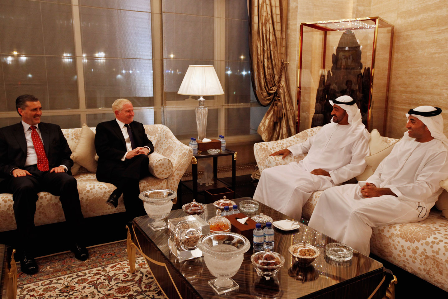 ABU DHABI, UNITED ARAB EMIRATES - APRIL 08: U.S. Defense Secretary Robert Gates (2nd L) meets with Mohammed bin Zayed bin Sultan Al Nahyan (2nd R), the Crown Prince of Abu Dhabi and Deputy Supreme Commander of the United Arab Emirates Armed Forces, U.S. Ambassador to the UAE Richard Olson (L) and UAE Ambassador to the U.S. Yousef Al Otaiba (R) at the crown prince's home, the Mina Palace, April 8, 2011 in Abu Dhabi, United Arab Emirates. Gates visited Saudi Arabia and Iraq on this trip and will discuss the bilateral defense, and the unrest that is gripping the Mideast and Iran with the crown prince. (Photo by Chip Somodevilla/Getty Images)