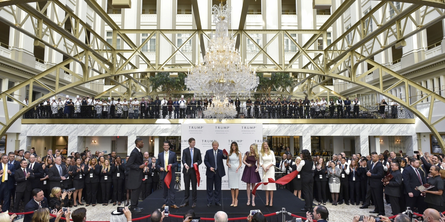 From left: Donald Trump Jr, Eric Trump, Republican presidential nominee Donald Trump, Melania Trump, Tiffany Trump, and Ivanka Trump take part in a ribbon cutting ceremony during the grand opening of the Trump International Hotel in Washington, DC on October 26, 2016. / AFP / Mandel Ngan        (Photo credit should read MANDEL NGAN/AFP/Getty Images)