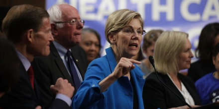 WASHINGTON, DC - SEPTEMBER 13:  U.S. Sen. Elizabeth Warren (D-MA) (C) speaks on health care as Sen. Bernie Sanders (I-VT) (2nd L) listens during an event September 13, 2017 on Capitol Hill in Washington, DC. Sen. Sanders held an event to introduce the Medicare for All Act of 2017.  (Photo by Alex Wong/Getty Images)