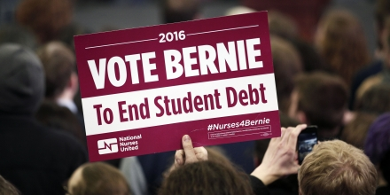 YPSILANTI, MI - FEBRUARY 15:  A supporter of U.S. Senator and Democratic Presidential Candidate Bernie Sanders  holds a sign at Sanders' first campaign rally in Michigan at Eastern Michigan University February 15th, 2016 in Ypsilanti, Michigan. At his