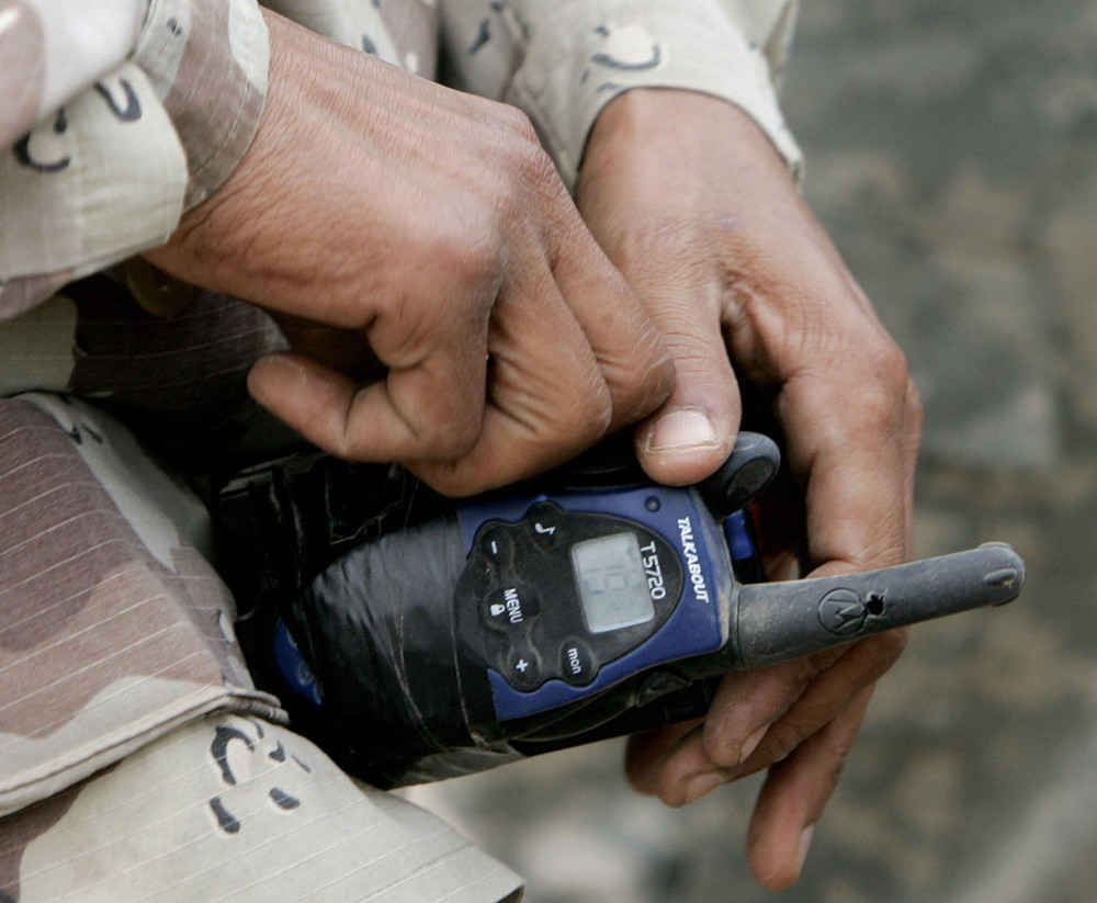 HAWIJAH, Iraq:  An Iraqi soldier checks the detonator on spot where an Improvised Explosive Device blew up as a convoy of the 1st battalion 327th infantry regiment was driving along a country road on the outskirts of the northern city of Hawijah,  25 December 2005. A US soldier was killed by a roadside bomb on Christmas day, in Baghdad, the US military said. AFP PHOTO / Filippo MONTEFORTE  (Photo credit should read FILIPPO MONTEFORTE/AFP/Getty Images)