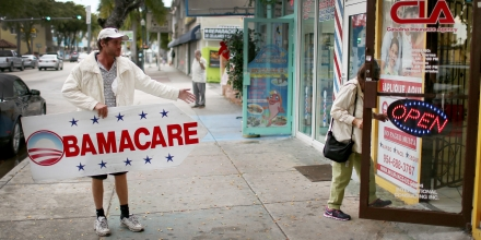 MIAMI, FL - FEBRUARY 05:  Pedro Rojas holds a sign directing people to an insurance company where they can sign up for the Affordable Care Act, also known as Obamacare, before the February 15th deadline on February 5, 2015 in Miami, Florida. Numbers released by the government show that the Miami-Fort Lauderdale-West Palm Beach metropolitan area has signed up 637,514 consumers so far since open enrollment began on Nov. 15, which is more than twice as many as the next largest metropolitan area, Atlanta, Georgia.  (Photo by Joe Raedle/Getty Images)
