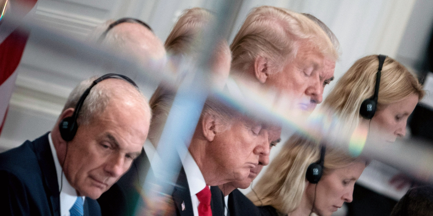 White House Chief of Staff John Kelly (L) and US President Donald Trump are seen in a mirror as they listen to opening statements before a luncheon with US and African leaders at the Palace Hotel during the 72nd United Nations General Assembly on September 20, 2017 in New York. / AFP PHOTO / Brendan Smialowski        (Photo credit should read BRENDAN SMIALOWSKI/AFP/Getty Images)