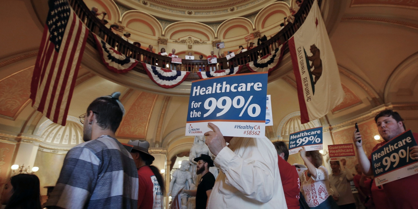 Members of the california nurses association and supporters rally in the rotunda at the capitol calling