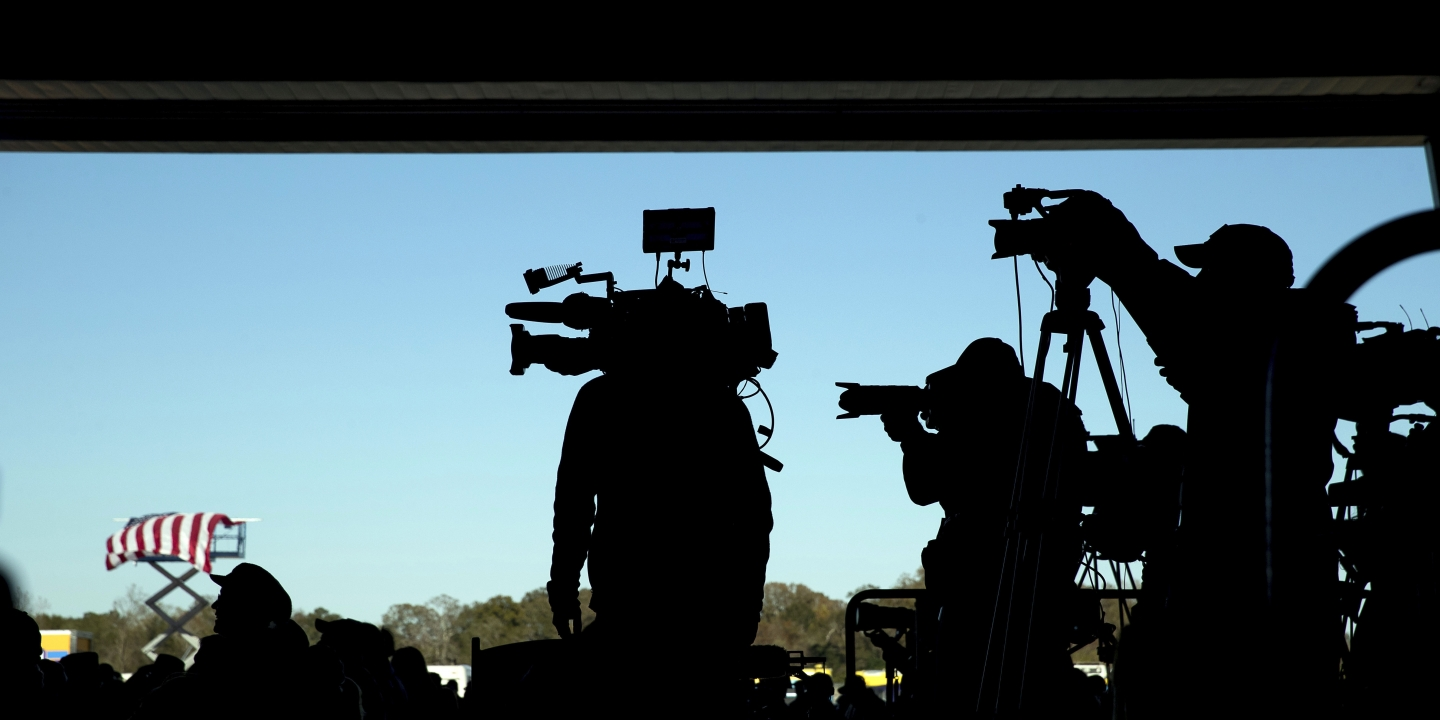 Members of the media stand on a back riser as President-elect Donald Trump speaks at a rally in a DOW Chemical Hanger at Baton Rouge Metropolitan Airport, Friday, Dec. 9, 2016, in Baton Rouge, La. (AP Photo/Andrew Harnik)