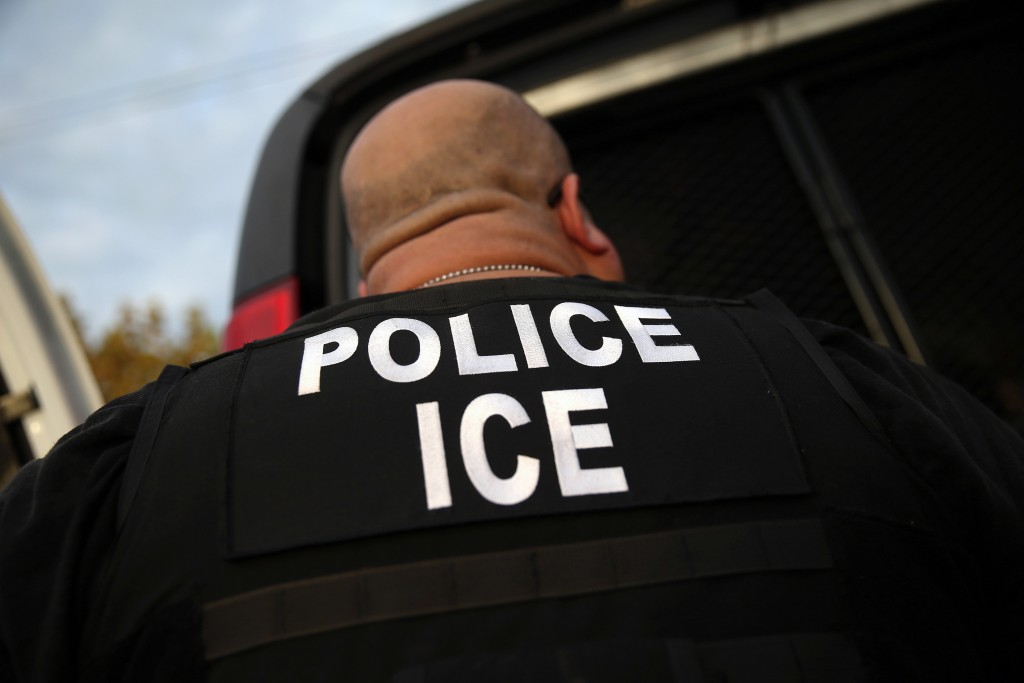 LOS ANGELES, CA - OCTOBER 14: U.S. Immigration and Customs Enforcement (ICE), agents detain an immigrant on October 14, 2015 in Los Angeles, California. ICE agents said the immigrant, a legal resident with a Green Card, was a convicted criminal and member of the Alabama Street Gang in the Canoga Park area. ICE builds deportation cases against thousands of immigrants living in the United States. Green Card holders are also vulnerable to deportation if convicted of certain crimes. The number of ICE detentions and deportations from California has dropped since the state passed the Trust Act in October 2013, which set limits on California state law enforcement cooperation with federal immigration authorities. (Photo by John Moore/Getty Images)