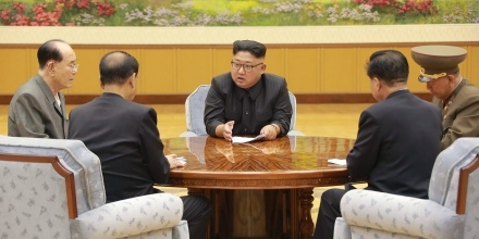 TOPSHOT - This picture taken on September 3, 2017 and released by North Korea's official Korean Central News Agency (KCNA) on September 4, 2017 shows North Korean leader Kim Jong-Un (C) attending a meeting with a committee of the Workers' Party of Korea about the test of a hydrogen bomb, at an unknown location.North Korea said it detonated a hydrogen bomb designed for a long-range missile on September 3 and called its sixth and most powerful nuclear test a