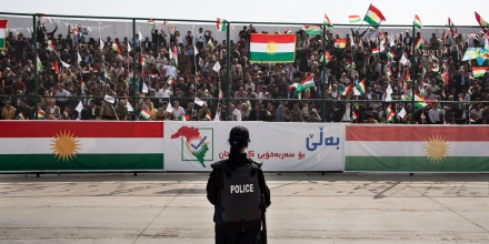SULAIMANIYAH, IRAQ: A female riot police officer watches the crowd at the Sulaimaniyah Stadium during a pro-independence rally.Iraqi Kurdish president, Masoud Barzani, has called for a referendum on Kurdish independence for September 25th. It is opposed by the central Iraqi government and many external countries including the US.Photo by Sebastian Meyer