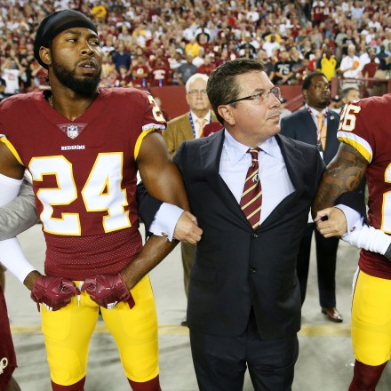 Washington Redskins Owner Daniel Synder stands with cornerback Josh Norman (24) and cornerback Bashaud Breeland (26) during the the national anthem before the NFL football game against the Oakland Raiders at FedExField on Sept. 24, 2017 in Landover, Md.