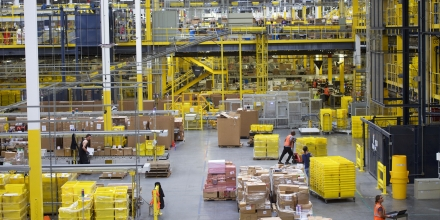 ROBBINSVILLE, NJ - AUGUST 1:  Employees work at the Amazon Fulfillment Center on August 1, 2017 in Robbinsville, New Jersey.  The more than 1 million square feet facility holds tens of millions of products, features more than 14 miles of conveyor belts, and employs more than 4,000 workers who pick, pack, and ship orders.  Tomorrow Amazon will host a jobs fair to hire 50,000 positions in their fulfillment centers nationwide.  (Photo by Mark Makela/Getty Images)