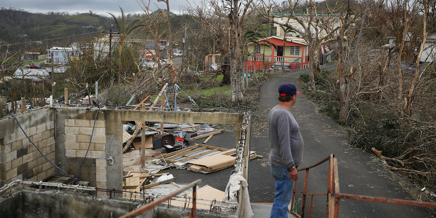 HAYALES DE COAMO, PUERTO RICO - SEPTEMBER 24: Telesforo Menendez surveys the damage in his neighborhood September 24, 2017 in Hayales de Coamo, Puerto Rico. Puerto Rico experienced widespread damage after Hurricane Maria, a category 4 hurricane, passed through. (Photo by Joe Raedle/Getty Images)
