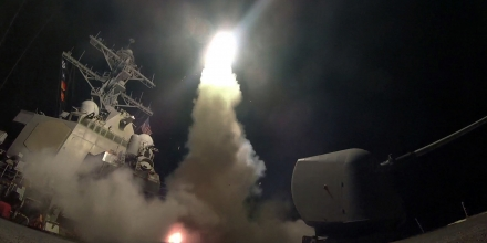 In this image provided by the U.S. Navy, the guided-missile destroyer USS Porter (DDG 78) launches a tomahawk land attack missile in the Mediterranean Sea, Friday, April 7, 2017.  President Donald Trump's decision to launch missiles at Syria government risked rising tensions with Iran, a key backer of Syrian President Bashar Assad in a conflict with dangerously blurry battle lines. (Mass Communication Specialist 3rd Class Ford Williams/U.S. Navy via AP)