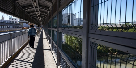 People walk at the international bridge on the US/Mexico border in Nuevo Laredo on February 22, 2017 northern Mexico. Attention Editors: This image is part of an ongoing AFP photo project documenting the life on the two sides of the US/Mexico border simultaneously by two photographers traveling for ten days from California to Texas on the US side and from Baja California to Tamaulipas on the Mexican side between February 13 and 22, 2017. You can find all the images with the keyword : BORDERPROJECT2017 on our wire and on www.afpforum.com / AFP / GUILLERMO ARIAS (Photo credit should read GUILLERMO ARIAS/AFP/Getty Images)