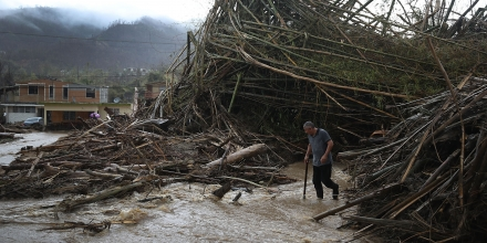 UTUADO, PUERTO RICO - OCTOBER 06:  A man walks through a road that has been turned into a river caused by heavy rains after Hurricane Maria passed through on October 6, 2017 in Utuado, Puerto Rico. The neighborhood continues to wait for government aid to arrive almost 15 days after the hurricane hit the island.  (Photo by Joe Raedle/Getty Images)