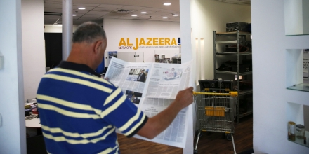 An employee of the Qatar based news network and TV channel Al-Jazeera is seen at the channel's Jerusalem office on July 31, 2017.Israel said on August 6, 2017 that it planned to close the offices of Al-Jazeera after Prime Minister Benjamin Netanyahu accused the Arab satellite news broadcaster of incitement. A statement from the communications ministry said it would demand the revocation of the credentials of journalists working for the channel and also cut its cable and satellite connections. / AFP PHOTO / AHMAD GHARABLI (Photo credit should read AHMAD GHARABLI/AFP/Getty Images)