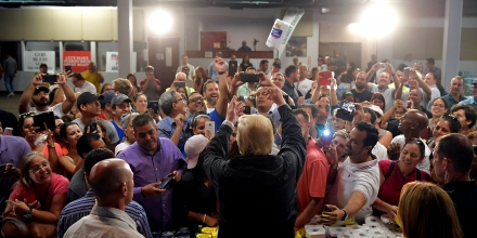US President Donald Trump takes part in a food and suplly distribution at the Cavalry Chapel in Guaynabo, Puerto Rico on October 3, 2017.Nearly two weeks after Hurricane Maria thrashed through the US territory, much of the islands remains short of food and without access to power or drinking water. / AFP PHOTO / MANDEL NGAN (Photo credit should read MANDEL NGAN/AFP/Getty Images)