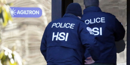 Agents from the U.S. Immigration and Customs Enforcement's Homeland Security Investigations (HSI) unit enter the offices of Agiltron in Woburn, Massachusetts, U.S., on Wednesday, Jan. 23, 2013. Agiltron describes itself as providing clients with