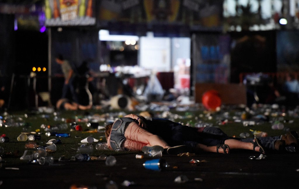 LAS VEGAS, NV - OCTOBER 01: (EDITORS NOTE: Image contains graphic content.) A person lies on the ground covered with blood at the Route 91 Harvest country music festival after apparent gun fire was heard on October 1, 2017 in Las Vegas, Nevada. There are reports of an active shooter around the Mandalay Bay Resort and Casino. (Photo by David Becker/Getty Images)