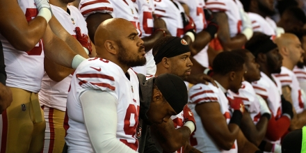 INDIANAPOLIS, IN - OCTOBER 08: Xavier Cooper #96 of the San Francisco 49ers and other members of the team kneel during the National Anthem before the game against the Indianapolis Colts at Lucas Oil Stadium on October 8, 2017 in Indianapolis, Indiana.  (Photo by Bobby Ellis/Getty Images)
