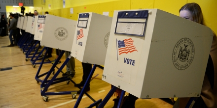 People vote for the next US president in the general election at a polling station in a school gymnasium in New York, November 8, 2016.Polling stations opened Tuesday as the first ballots were cast in the long-awaited election pitting Hillary Clinton against Donald Trump. / AFP / Robyn Beck (Photo credit should read ROBYN BECK/AFP/Getty Images)