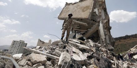 TOPSHOT - A Yemeni soldier stands on the debris of a house, hit in an air strike on a residential district, in the capital Sanaa on August 26, 2017.Children were among at least 14 people killed in an air strike that toppled residential blocks in Yemen's capital Sanaa on Friday, witnesses and medics said. / AFP PHOTO / MOHAMMED HUWAIS (Photo credit should read MOHAMMED HUWAIS/AFP/Getty Images)