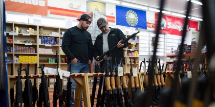 Customers look at a long gun at a gun shop on November 5, 2016, in Merrimack, New Hampshire.According to the proprietor, October's sales in his store were double that of 2015, with customers expressing anxiety about the November election. / AFP / DOMINICK REUTER (Photo credit should read DOMINICK REUTER/AFP/Getty Images)