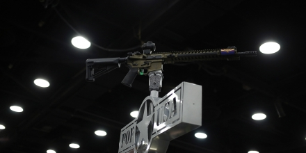 An AR-15 rifle is displayed on top of a booth on the exhibit floor during the National Rifle Association (NRA) annual meeting in Louisville, Kentucky, U.S., on Friday, May 20, 2016. The nation's largest gun lobby, the NRA has been a political force in elections since at least 1994, turning out its supporters for candidates who back expanding access to guns. Photographer: Luke Sharrett/Bloomberg via Getty Images