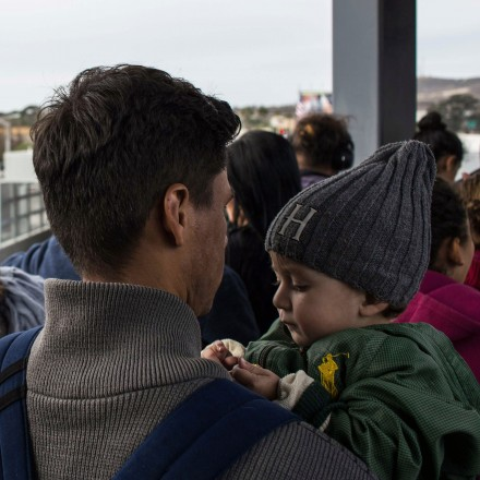 Central American migrants seeking for asylum in the United States, walk to the US-Mexico border at El Chaparral port of entry on November 12, 2017, in Tijuana, northwestern Mexico. The self-called