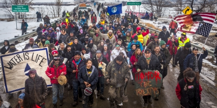 NORTH DAKOTA, UNITED STATES - 2017/02/22: Defiant Dakota Access Pipeline water protectors faced-off with various law enforcement agencies on the day the camp was slated to be raided. Many protesters and independent journalist, who were all threatened with multiple felony charges if they didn't leave were met with militarized police on the road abutting the camp. At least six were arrested, including a journalist who reportedly had sustained a broken hip. (Photo by Michael Nigro/Pacific Press/LightRocket via Getty Images)